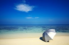 Umbrella on a beach Royalty Free Stock Photo