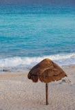 Parasol on sandy beach Royalty Free Stock Photography