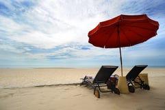 Umbrella and beach chair Stock Photo