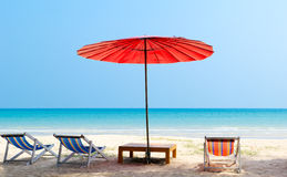 Umbrella and beach chair on the tropical beach Stock Image