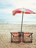 Umbrella with beach chairs Stock Photo