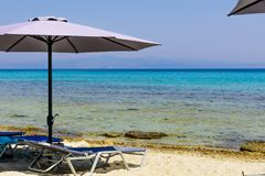 Umbrella on the beach. With clear water and Royalty Free Stock Photography