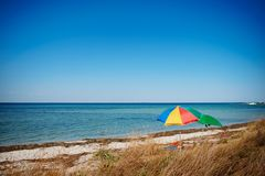 umbrella on the beach with cloudy blue sky in background royalty free stock image