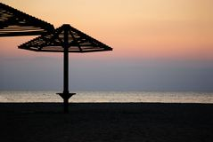 Umbrella on a beach. Evening Stock Photography