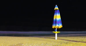 Umbrella on the beach at night Stock Images
