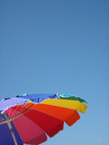 Umbrella at the beach. A beach umbrella on a perfectly clear day stock photography