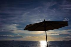 Umbrella beach sea sky beautiful silhouette Royalty Free Stock Image