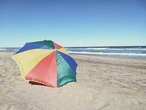 Umbrella alone in a brach. Umbrella beach sea solitary Royalty Free Stock Photos