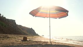 Umbrella on beach. Sky and seashore. Far from bustle and noise stock video