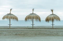 Umbrella of beach. Beach umbrellas on a day in December with the empty Beach Royalty Free Stock Photo