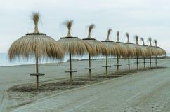 Umbrella of beach. Beach umbrellas on a day in December with the empty Beach Stock Photo