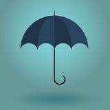 umbrella on a blue background. Text can be added Stock Photos