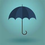umbrella on a blue background Stock Photos