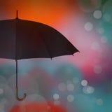 Umbrella on blue orange background Royalty Free Stock Image