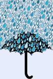 Umbrella and blue rain drops Stock Images