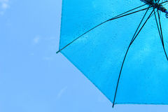 Umbrella and blue sky Stock Images