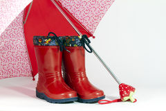 Umbrella and boots Stock Photography