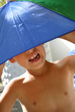 Umbrella Boy. Boy with Umbrella hat in the sun Stock Photography
