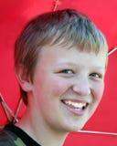 Umbrella Boy 3. Boy with a red umbrella, taken outdoors royalty free stock photography