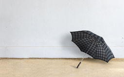 Umbrella with brick wall Royalty Free Stock Images