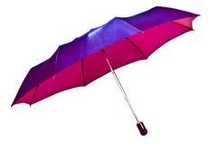 Umbrella brightly crimson on a white Stock Image