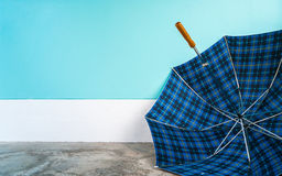 Umbrella on cement floor with pastel wall background Royalty Free Stock Photography