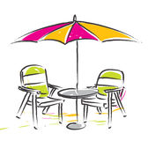 Umbrella and chair Stock Photography