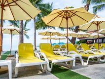 Umbrella and chair around luxury outdoor swimming pool stock photos