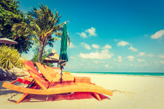 Umbrella and chair on the beach. Vintage Filter - Umbrella and chair on beautiful tropical beach and sea - Boost up color Processing - Holiday vacation concept Stock Photo