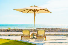 Umbrella and chair with sea view Stock Photos