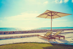 Umbrella and chair with sea view Royalty Free Stock Photography