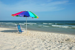 Umbrella and Chair on Shore. Umbrella and chair on the shore stock photos