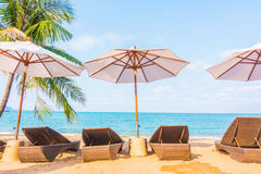 Umbrella and chair on the tropical beautiful beach Royalty Free Stock Photo