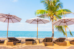 Umbrella and chair on the tropical beautiful beach Royalty Free Stock Image