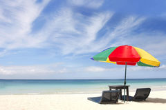 Umbrella and chairs on beach Stock Image