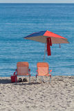 Umbrella and Chairs on Beach Stock Photography