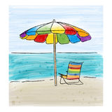 Umbrella and chairs at the sea shore and the sea. Royalty Free Stock Images