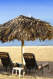 Umbrella and chaise lounges on a beach Stock Image
