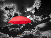 Umbrella and clouds Stock Photo