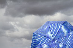 Umbrella with cloudy background Royalty Free Stock Photo