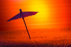 Umbrella for a cocktail. Against a decline Stock Image