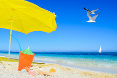 Umbrella and cocktail under flying gull Royalty Free Stock Images