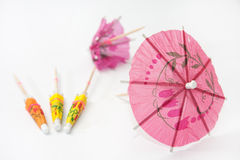 Umbrella for cocktails on a white background Royalty Free Stock Photo