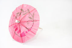 Umbrella for cocktails on a white background Royalty Free Stock Image