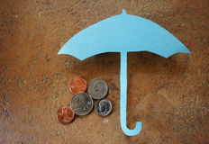 Umbrella coins Stock Image
