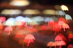 Umbrella. Colorful bokeh umbrella shape ,city at night royalty free stock images