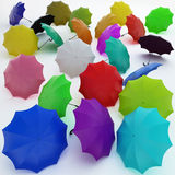 Umbrella_colors_scatter. Varicoloured umbrellas are scattered on a white plane Stock Images
