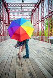 Umbrella couple. Couple in love on a bridge with an umbrella Stock Photography