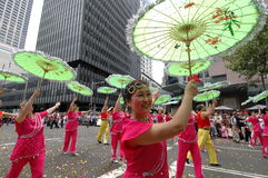 Umbrella dancers. Dancers with traditional umbrella in Chinese New Year parade celebration Royalty Free Stock Photos