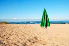 Umbrella On A Deserted Beach Stock Image